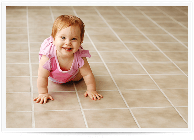 baby crawling on clean tile in brookhaven home