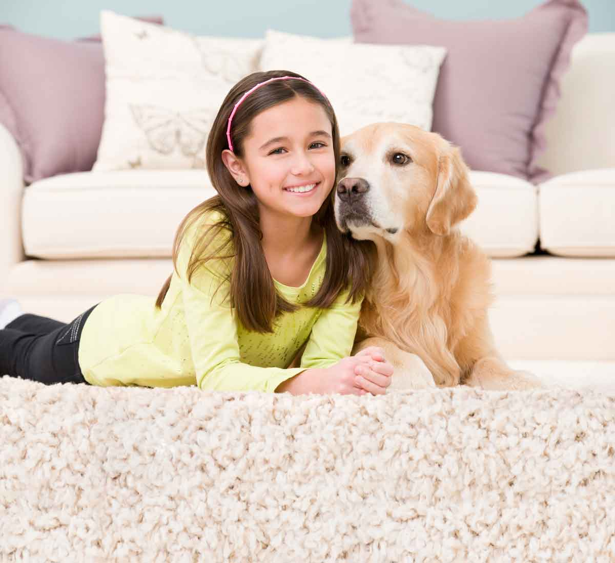 girl and dog laying on clean carpet in Atlanta home
