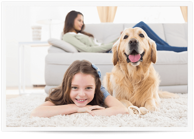 girl and dog laying on clean carpet in alpharetta home