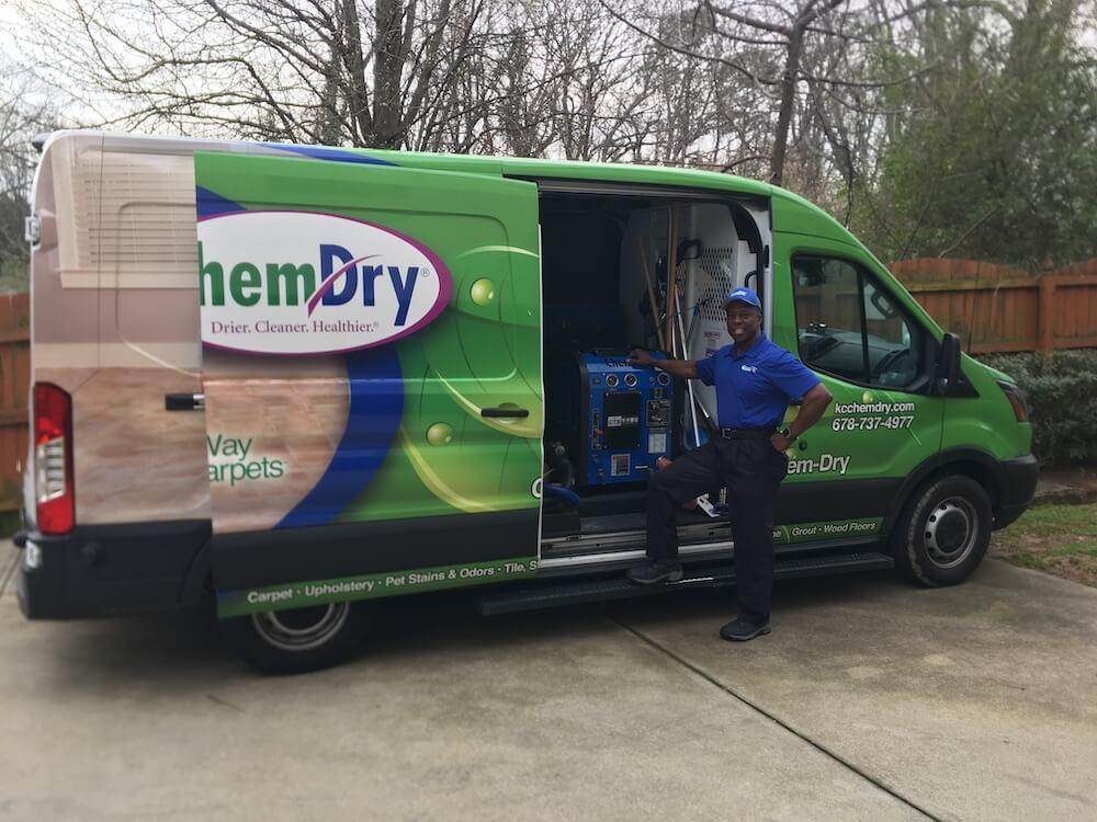 K&C Chem-Dry owner, Ivan, standing in front of green van