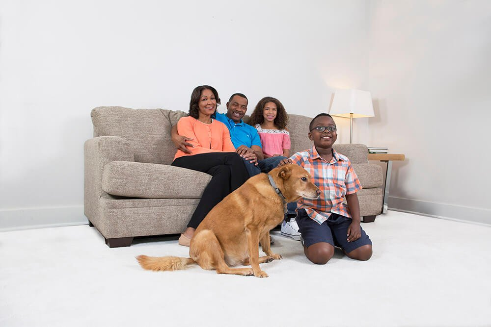 family sitting on couch in atlanta home