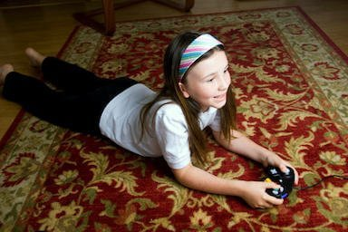 girl laying on area rug in forsyth county ga home